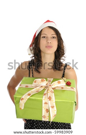 Pretty young woman holding christmas gift and sending kiss - stock photo