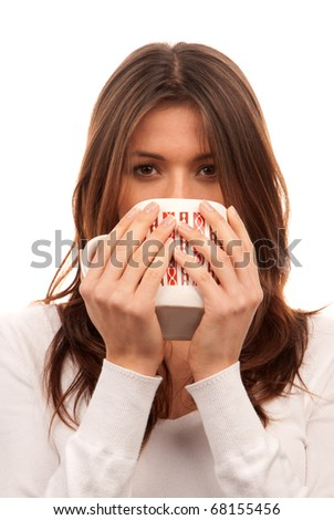 Pretty young woman holding red pattern mug of tea / coffee in hands isolated on white background - stock photo