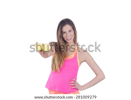 Pretty young woman holding tennis balls against a white background - stock photo