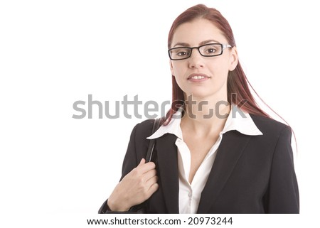 Pretty young woman in business attire looking confident - stock photo
