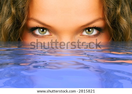Pretty young woman in clean blue water - stock photo