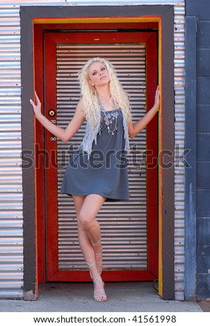 Pretty Young Woman in colorful Doorway - stock photo