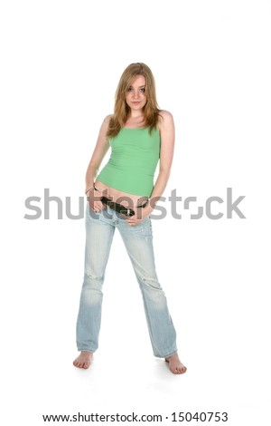 pretty young woman in green shirt standing - stock photo