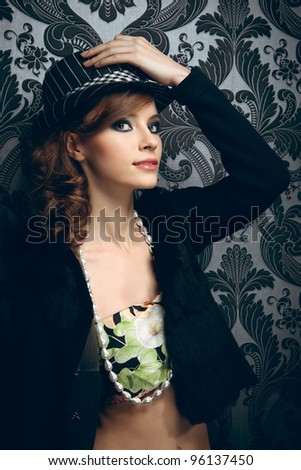 Pretty young woman in hat - stock photo