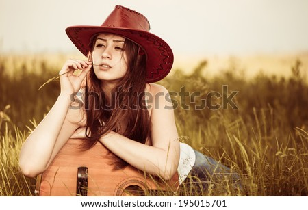 pretty young woman in hat at spring meadow - stock photo