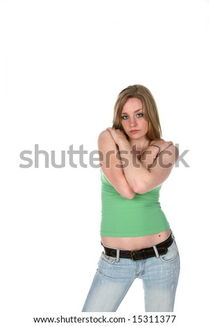pretty young woman in low rise jeans and arms crossed - stock photo