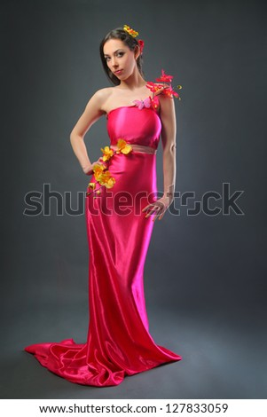 pretty young woman in pink long dress
