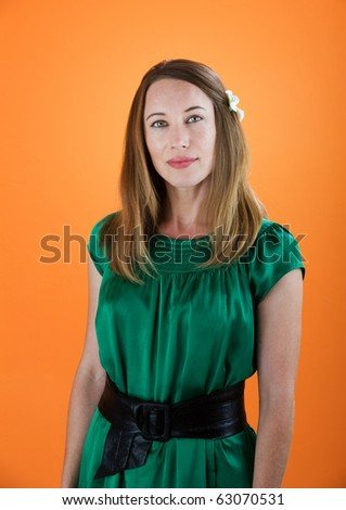 Pretty Young Woman in Shiny Green Dress - stock photo