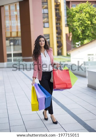 Pretty young woman in shopping - stock photo