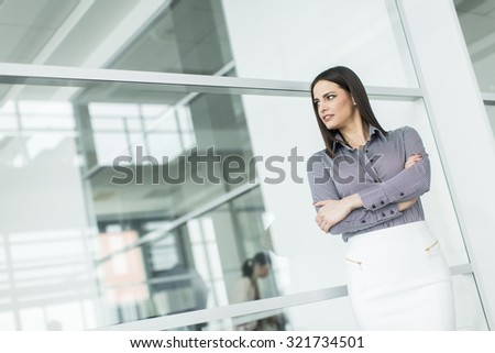 Pretty young woman in the modern office