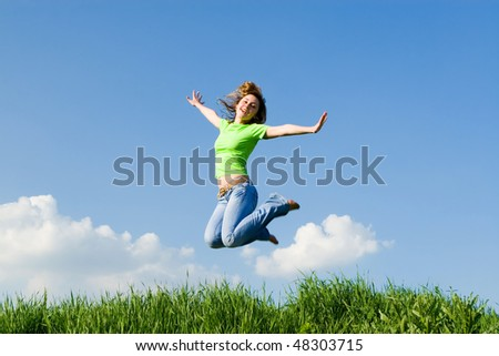 pretty young woman is jumping - stock photo