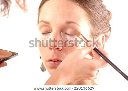 pretty young woman is make up on white background