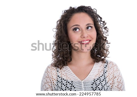 Pretty young woman isolated over white looking sideways to text: promotion and advertising. - stock photo