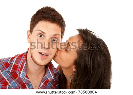 pretty young  woman kisses her boyfriend on the cheek - stock photo
