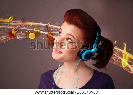 Pretty young woman listening to music, instruments concept - stock photo