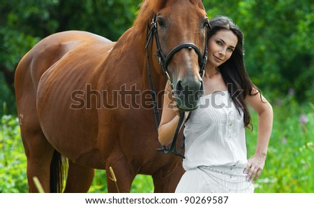 pretty young woman long-haired long white dress next horse - stock photo