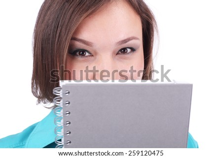 pretty young woman looking out of the grey book - stock photo
