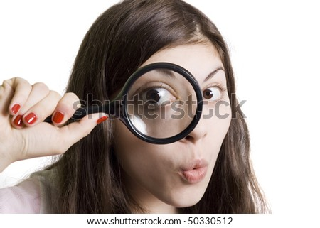 pretty young woman looking through magnifying - stock photo