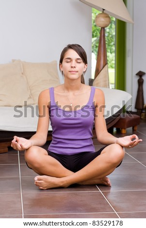 Pretty young woman meditating