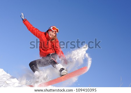 pretty young woman on snowboard - stock photo