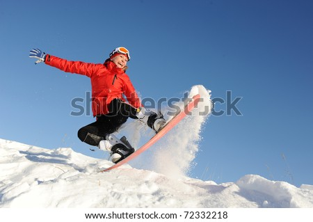 pretty young woman on snowboard