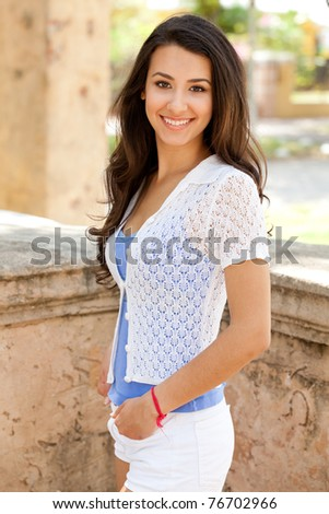 Pretty young woman outdoor in a casual lifestyle pose.