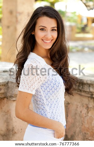 Pretty young woman outdoor in a casual lifestyle pose. - stock photo