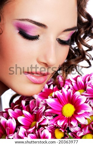 Pretty young woman portrait with chrysanthemum - stock photo