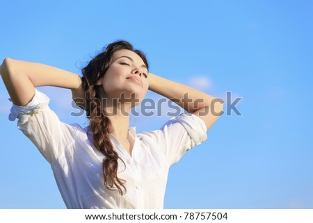 Pretty young woman relaxing after hard working day - stock photo