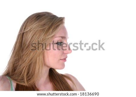 pretty young woman's profile on high key background - stock photo