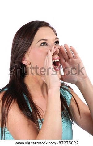 Pretty young woman shouting out good news announcement - stock photo