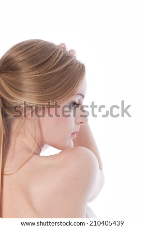 Pretty Young Woman Showing Smooth Skin on White Background. Photo Shoot for Skin Care. - stock photo