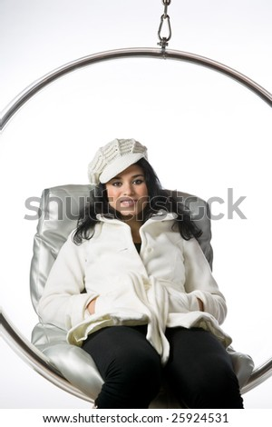 Pretty young woman sitting in a bubble chair