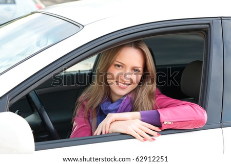 Pretty Young Woman Sitting In Car. - stock photo