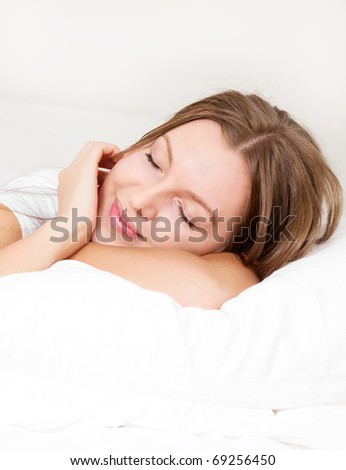 pretty  young woman  sleeping on the white linen
