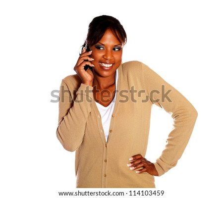 Pretty young woman speaking on cellphone on isolated background