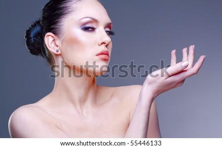Pretty young woman stylish studio portrait - stock photo