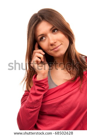 Pretty young woman talking on new cell phone mobile isolated on a white background - stock photo