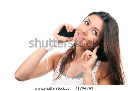 Pretty young woman talking on the mobile phone listening music on her new cellular touch mp3 player in headphones isolated on white background