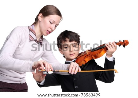 pretty young woman teaching little handsome boy to play a violin - stock photo