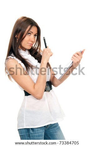 Pretty young woman thinking, holding pen and a notebook textbook in her hands on a white background. - stock photo