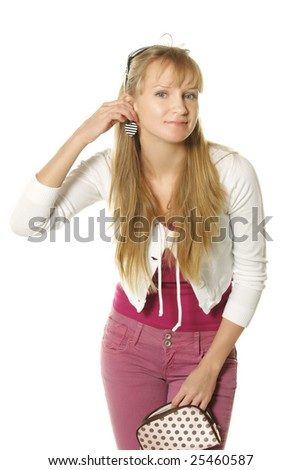 Pretty young woman trying on heart shaped ear-ring