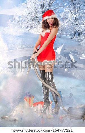 Pretty young woman vacuuming the snow around the Christmas gifts - stock photo