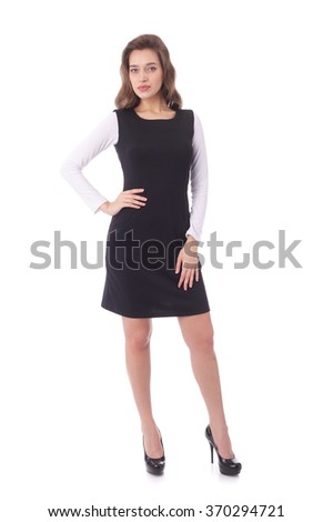 pretty young woman wearing black and white dress - stock photo