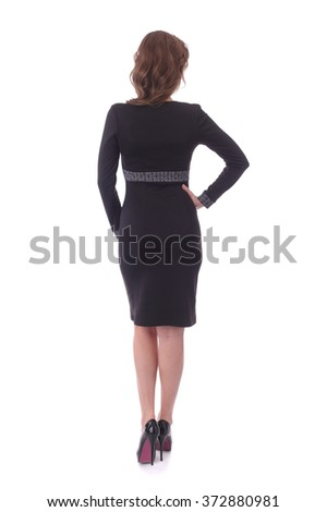 pretty young woman wearing black dress - stock photo