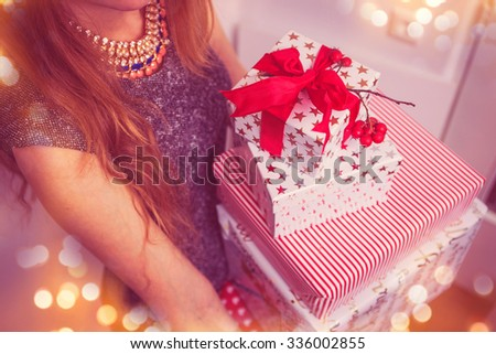 Pretty young woman wearing Gifts