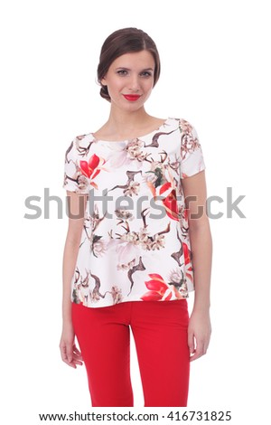 pretty young woman wearing summer flower printed blouse and red pants - stock photo
