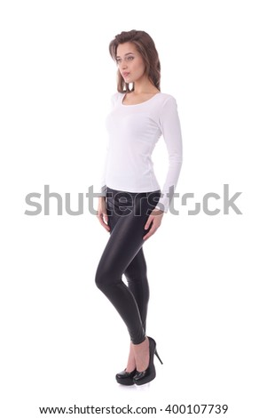pretty young woman wearing white top and black pants - stock photo