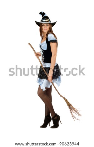 Pretty young woman with a besom wearing costume witch