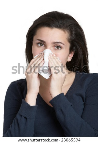 Pretty young woman with a cold blowing nose - stock photo
